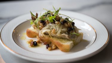 Sardine with pickled onion, toasty pinenuts and blackcurrants on a slice of focaccia.