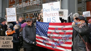 Demonstrators show  solidarity with the press in front of The New York Times building in  February.