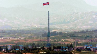 A giant North Korean flag flutters on the top of a tower in North Korea seen from the Demilitarised Zone near the border village of Panmunjom.