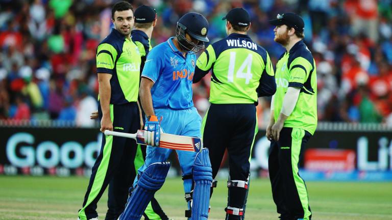 Stuart Thompson of Ireland celebrates after bowling Rohit Sharma of India.