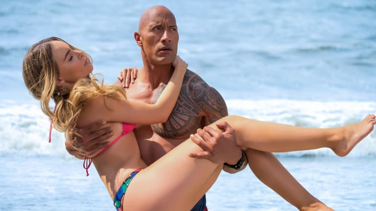 Mitch Buchannon (Dwayne Johnson) carries Carmen (Belinda) in a scene from Baywatch.