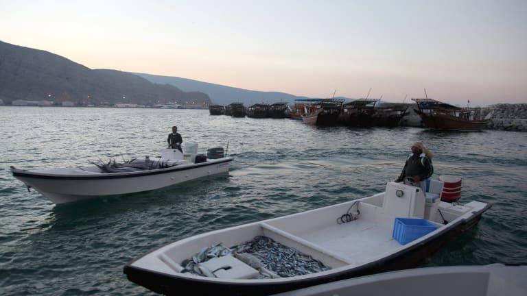 Fishermen bring in their catch at Khasab, on Oman's northern Musandam Peninsula.