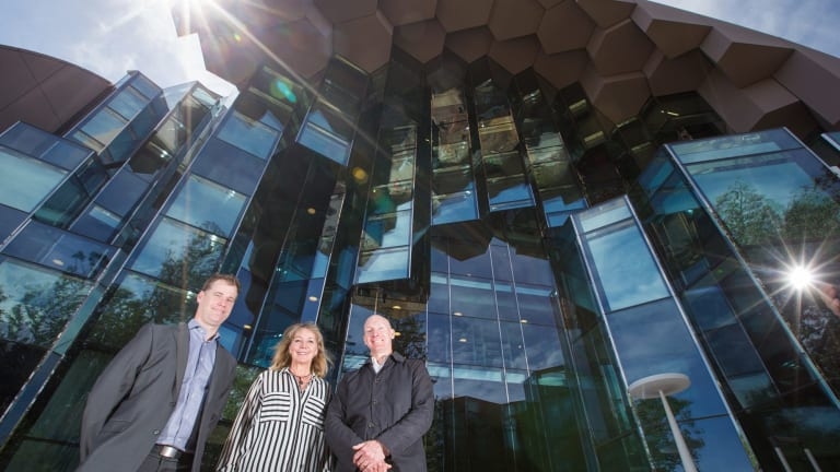 City of Greater Geelong capital projects manager Scott Cavanagh, arts and culture manager Kaz Paton and ARM Architects technical director Wayne Sanderson  in front of the new $45 million Geelong Library and Heritage Centre.