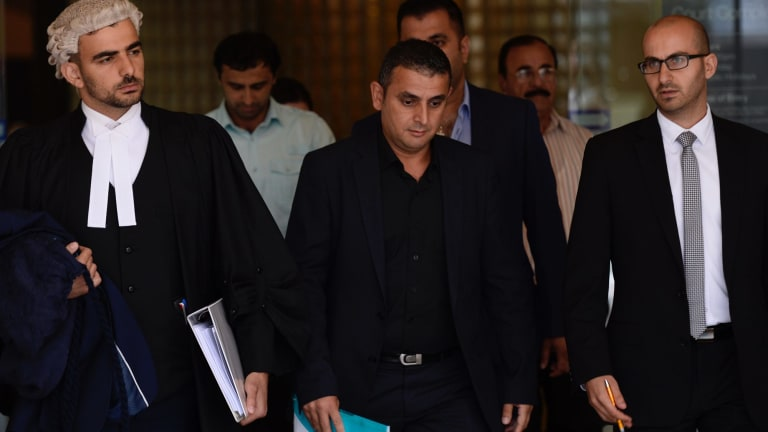 Sarmad Nisan, centre, outside court in January.