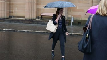 Lucy McNamara tries to evade the media after Friday's sentencing.