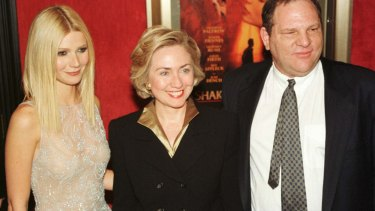 Actress Gwyneth Paltrow poses with Hillary Rodham Clinton and Harvey Weinstein as they arrive for the premiere of Shakespeare in Love in 1999.