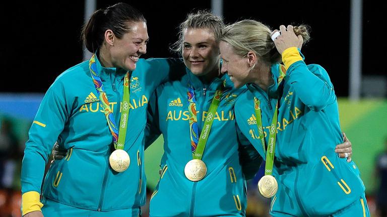 Sharni Williams, left, with her Australian teammates.