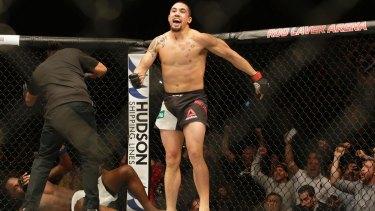 Robert Whittaker of Australia celebrates winning the main after defeating Derek Brunson of America in UFC Fight Night at Rod Laver Arena.