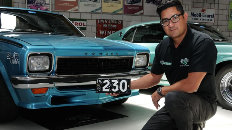 Shannons national auction manager Christophe Boribon with the number plate that sold for $135,000 last month.