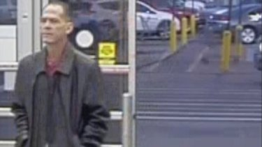 An image released by local police shows shooting suspect Scott Ostrem walking into a Walmart in Thornton before opening fire.