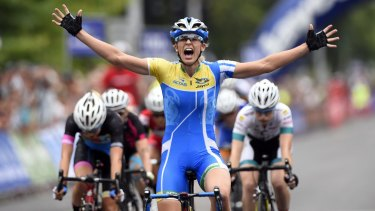 Kimberley Wells wins the women's criterium at the Australian road cycling championships.