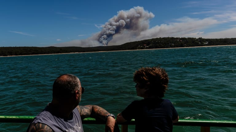 A bushfire burning in the Royal National Park is seen from the Cronulla-to-Bundeena Ferry.