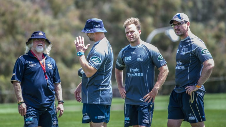 Peter Ryan, centre, with the Brumbies coaching staff.