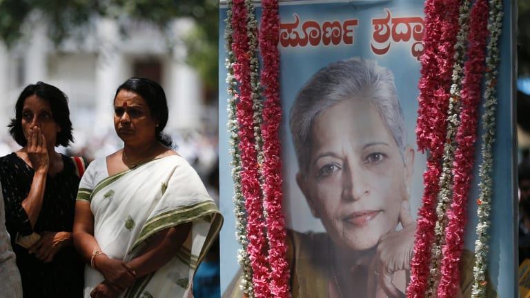 Mourners next to a portrait of Gauri Lankesh during the public viewing of her body in Bangalore on Wednesday.