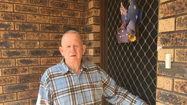 Vietnam veteren Les King had his Australian flags cut down by Minto neighbour Ihsas Khan.