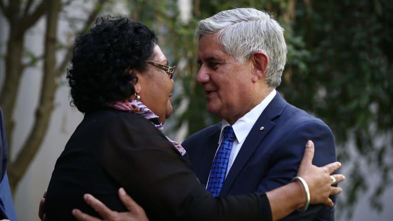 June Oscar is embraced by Minister for Indigenous Health Ken Wyatt.