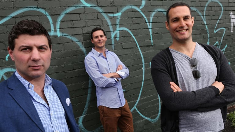 Bluethumb co-founder Ed Hartley is flanked by investors Adam Schwab, left and Jeremy Same.