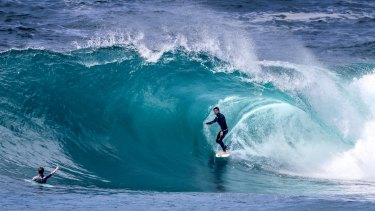 Pro surfer Perth Standlick stands tall in a clean barrel at Cape Solander on Wednesday.