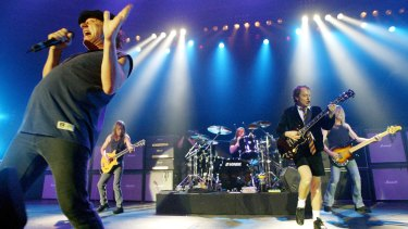 AC/DC perform in Germany in 2003, with Malcolm Young second from left.