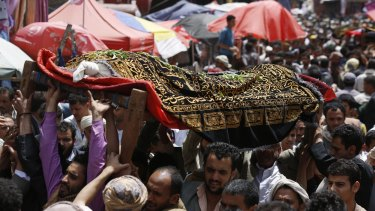 People carry the body of a Yemeni who was killed in a Saudi-led airstrike, during the funeral in the Old City of Sanaa on Saturday.