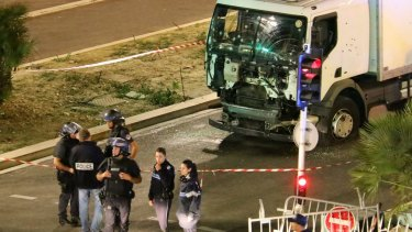 Police investigate the scene after a truck plowed through Bastille Day revellers in the French resort city of Nice.