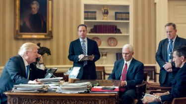 From left: US President Donald Trump, with Chief of Staff Reince Priebus, Vice-President Mike Pence, Press Secretary Sean Spicer and Michael Flynn, speaks on the phone with Russian President Vladimir Putin on January 28.