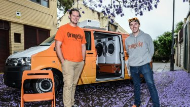 Brisbane friends Lucas Patchett (left) and Nicholas Marchesi are helping the homeless wash their clothes in a van fitted out with a washing machine and dryer.