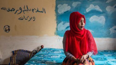 """""""My cousin still hasn't been found"""": Hanan Ibrahim, 25, is one of many Somalis living in Kenya affected by the attacks. The Arabic writing on the wall reads """"peace be upon you and the mercy of God and His blessings""""."""