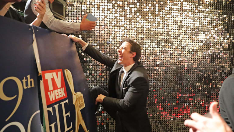 Gold Logie winner Samuel Johnson climbs into the crowd to meet fans at the 59th Annual Logie Awards at Crown.
