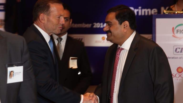 Then Prime Minister Tony Abbott with mining magnate Gautam Adani in Delhi in 2014.
