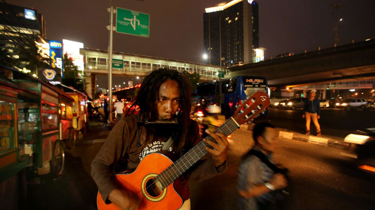 'Ho' Mulyono on the streets of Jakarta.  He has been detained three times and sent to social rehabilitation centres in Jakarta.