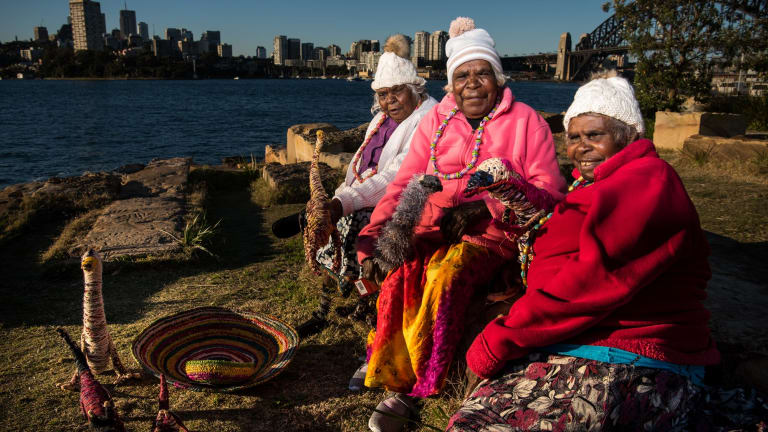 Artists (from left) Tjungkaya Tapaya, Iluwanti Ken and Mary Pan from the APY Art Centre Collective in Amata, South Australia. They are among Aboriginal artists from 11 remote Australian art centres who have brought their artwoks to Barangaroo Reserve.