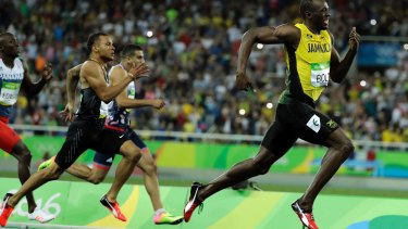 Usain Bolt from Jamaica leads to win the gold medal in the men's 200m final.