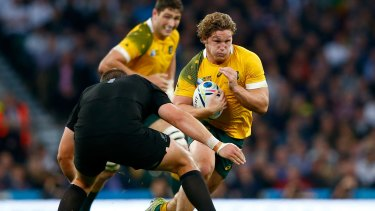 On the attack: Michael Hooper takes on the New Zealand defence during the 2015 Rugby World Cup Final at Twickenham.