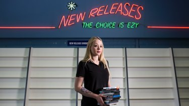 Video Ezy Phillip manager Jessica Farmer in front of the old new releases stand, which has been cleared in a closing down sale.