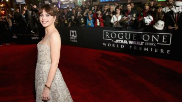 """Felicity Jones attends premiere of, """"Rogue One: A Star Wars Story"""" at the Pantages Theatre on December 10, 2016 in Hollywood, California."""