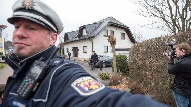 Police outside the home of the parents of Andreas Lubitz.