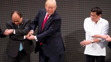 The moment US President Donald Trump realised he was doing the handshake incorrectly.