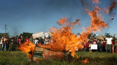 Locals set fire to a box with Woolies signage during a protest in Mullumbimby against a proposal to build a Woolworths in town in 2008.