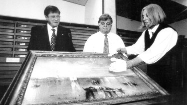 Former National Gallery of Australia chairman Kerry Stokes (left), deputy Brian Johns and director Betty Churcher examine Turner's <i>Camp Santo, Venice</i>, in 1996.
