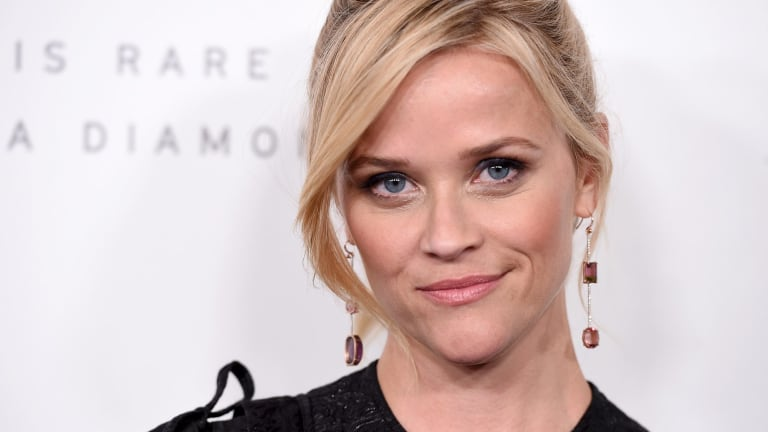 Actress Reese Witherspoon is among 300 powerful Hollywood women who have launched the Time's Up initiative against workplace harassment.
