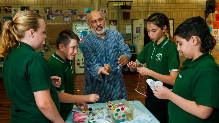 Arvind Gupta captivates the class including Emily Rudder 12, Marcus Andreatta 11, Lily Drew 11, and Tarek Charara 11 during his visit to Charnwood-Dunlop Primary School.