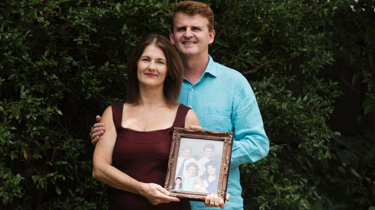 Cheryl and Ben Oxley with a family portrait that includes Cheryl's late mother.