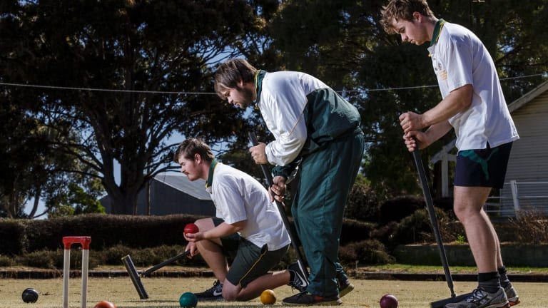 Concentration: (left to right) Greg, Robert and Mal Fletcher at Lismore Croquet club in western Victoria.