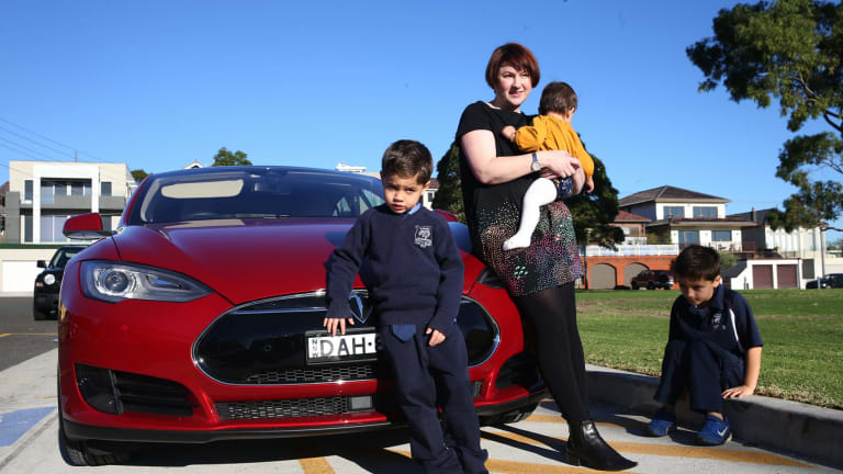 """""""I feel less guilty about driving"""": Belinda Sundaraj with her children and the family's electric car."""