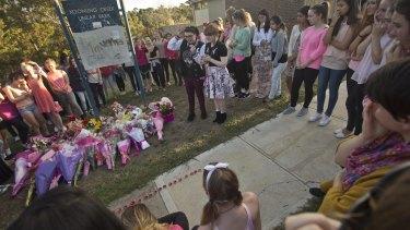Local residents congregate near where Masa Vukotic was killed.
