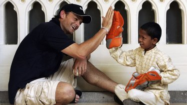 Adam Gilchrist with Mangesh, the child he sponsors through World Vision at the Taj Mahal hotel on October 17, 2006, in Mumbai.