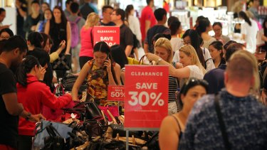 Crowds build at David Jones in Sydney CBD on Boxing Day.