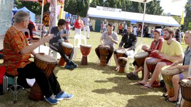 A drumming class at World Refugee Day event in Annerley.