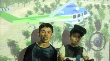 Joshua Edye,15 with his brother Kaiden, 12 playing a Snowy Hydro Southcare simulation game.